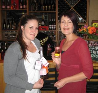 Ella Grimston and Diana Rankin setting up the display in the tasting room.